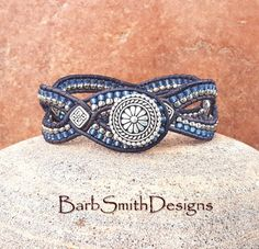 DVine One in Denim (Custom Order)  This light and graceful cuff bracelet will entwine your wrist with a leather trellis of Frosted Silver-Lined Denim and Nickel Plate seed beads accented with antique silver Celtic tiles. It is hand-stitched on a deep denim Indian Leather Cord and fastens with a 5/8 silver bali button and double beaded button loop. Style it for Spring! (Photo #4)  Bracelet Width: 3/4  Have the above shown bracelet custom made just for YOU!  CHOOSE YOUR SIZE: If you w...