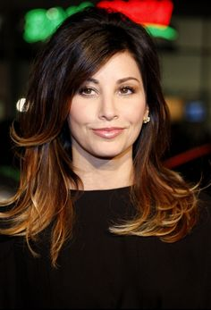 gina-gershon..umm yeah love Gina and her hair in this pic!