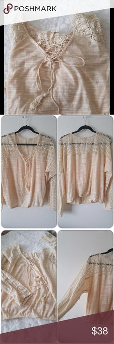 Anthropologie cream oversized top Loose bohemian style, light and airy, cute open lacy detail at sleeves and back. Brand new never worn. Size Large but Medium works too. Anthropologie Tops Sweatshirts & Hoodies