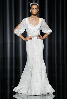Brides.com: Editor's Favorites: Winter Wedding Dresses. Pronovias  The light, sheer sleeves offer just enough coverage without being overly demure, while the intricate embroidery and crystal sash add a festive feel.  Elma, $5,200, Manuel Mota for Pronovias  See the complete Fall 2012 Pronovias collection here.