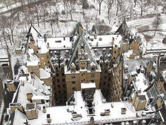 Aerial shot of The Dakota apartment building in snow. NYC