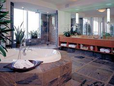 Sleek Open Shelving - 18 Savvy Bathroom Vanity Storage Ideas on HGTV