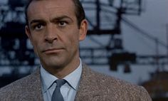 Sean Connery wearing a Donegal tweed coat in The Woman of Straw The Suits of James Bond James Bond, Sean Connery 007, Tweed Overcoat, Scottish Actors, Roger Moore, Video Film, Donegal, Old Hollywood, Style Icons