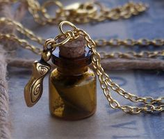 "SPELL in a BOTTLE Witch's Apothecary 22K Gold Goddess Burnt Scroll Dark Amber Vial Pendant Necklace on 24"" Gold Plated Chain - Gift Boxed by ArtisanWitchcrafts, $42.95"