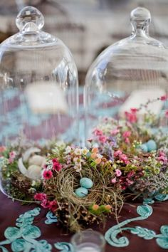 Easter centerpiece idea.  bird's nest with flowers under a cloche