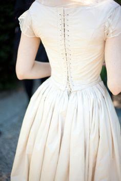 There is just something about the delicate sleeves and tiny waist that makes me want to have a full 1850's wedding...