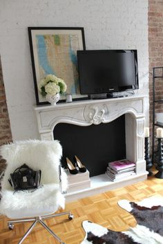 Faux fire place with marble mantel and chalkboard paint inside