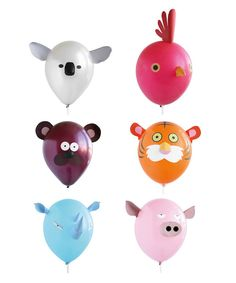 playful balloon animals at Oh Happy Day party store