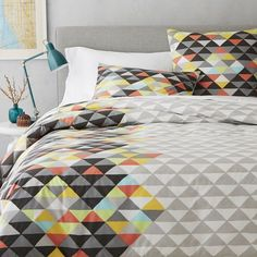 NEW! This Cubism-inspired bedding features a technicolor pattern that gives off a slight optical illusion. Pair it with solid sheets or neutral patterns for a playful, artsy look.