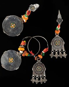 Maghreb | Two pairs of earrings in silver, inlaid silver, silver cloisonne, coral, amber and glass beads.