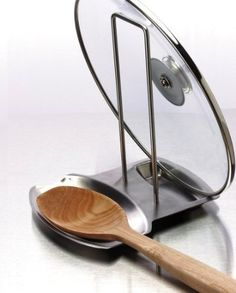 *Progressive International  Stainless Steel Lid and Spoon Rest |  The stainless steel stove top and spoon rest keeps tops and counters clean by preventing drips and lid rings. The sleek and stylish design in brushed stainless steel and looks great on any counter or stove. Holds most lids, splatter screens and cooking utensils.  #kitchen #gadgets