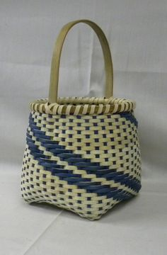Handwoven basket with inlayed brass diamond in the handle. $65.00, via Etsy.