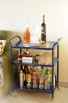 I think I want a bar cart and this person has the same glasses as I do.