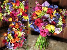 Vermont Wedding at Stowehof:  The bouquets were filled with fun jewel tones including dark blue delphinium, purple and lavender sweet peas, yellow freesia, orange ranunculus, raspberry pink roses, stock, mini-green hydrangea and sweet William.  The attendants wore pewter dresses so the colorful blooms were the perfect contrast.