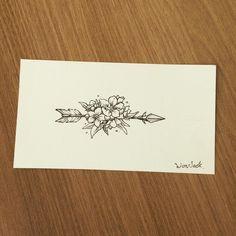 Arrow floral tattoo