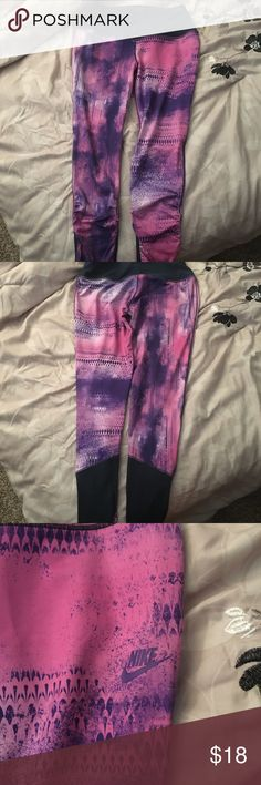 Girls NIKE Dri-fit pants Cute girls Nike dri-fit pants size Large...pink and purple pattern. Only worn once! Nike Pants Track Pants & Joggers