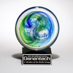 "Art Glass Round Disc with Blue Green Accents on a Black Glass Base comes with an etchable aluminum plate for recognition.  Stands 53/4"" x 71/4"" Etching is included in price."