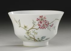A FAMILLE-ROSE 'FLOWER AND BUTTERFLY' BOWL. YONGZHENG MARK AND PERIOD  thinly potted with angled sides rising from a straight foot to a flared rim, delicately painted on the exterior in pastel enamels with a pink blossomed stem extending out towards a butterfly, the interior with two scattered orchids, six-character mark in underglaze blue