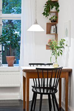 Seconding the flush-against-the-wall idea. Looks quaint, cozy.