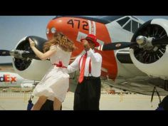 Swing Dancing in an Airport hanger!! That is so vintage: Planes and Swing dancing. :)  I so badly want to learn to swing dance, it looks soo fun!!