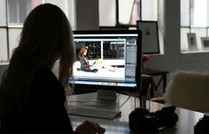 Sarah Winchester edits photos in her Boston-based photography studio