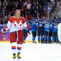 Alex Ovechkin skates off the ice after host Russia was eliminated by Finland in the quarterfinals, 3-1.