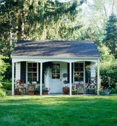 The roof on this porch extends to create a covered patio. This shed can serve as a daytime getaway for homeowners, or as a sleeping spot for grown-up guests or kids' slumber parties. Backyard Cottage, Backyard Sheds, Backyard Retreat, Cozy Cottage, Cottage Ideas, Cottage Porch, Cheap Sheds, Porche, Wooden Sheds