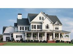 Love this home with wrap-around-porch.  I think I would prefer green shutters.