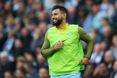Sergio Aguero Photos Photos - Sergio Aguero of Manchester City looks on as he warms up on the sidelines during the Premier League match between Manchester City and Leicester City at Etihad Stadium on May 13, 2017 in Manchester, England. - Manchester City v Leicester City - Premier League