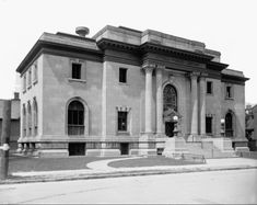 """The Carnegie Library. Notice the stained glass window above the entrance, and the words """"Ottawa Public Library"""" in raised letters on the lintel.Laurier Avenue and Metcalfe Street 30 April Carnegie Library, Library Architecture, Andrew Carnegie, Stained Glass Windows, Entrance, Mansions, Street, House Styles, Ottawa Ontario"""