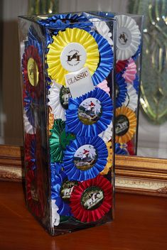 A pretty way to display those horse show ribbons and use any cool vases you might have.