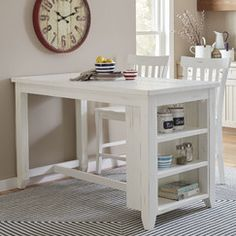 Frasier Breakfast Bar   Made with reclaimed pine and finished in a bright white hue, this counter-height island offers a look of rustic elegance. The island can double as both an eating and food prep space, while the built-in shelves can hold decor or cooking tools.