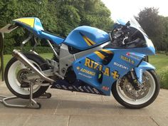 Sold a couple of years ago and occasionally regretted...Suzuki TL1000R, here lightly customized with an Honda RS250 seat and cheap custom exhausts, oh, and a paintjob!