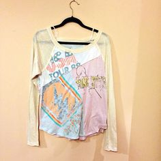 Free People Patchwork long sleeve tee Cute, fun fabrics. Interesting cut! Looks great on with jeans. Worn several times, but still good condition. 55% cotton, 35% polyester, 10% rayon Free People Tops Tees - Long Sleeve