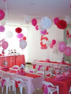 Red and pink decorations at a Hello Kitty birthday party! See more party ideas at CatchMyParty.com!