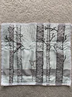 Woven strips of fabric and embroidery