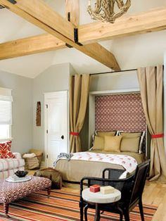 I like how this Murphy bed has drapes hanging on either side so it can easily be tucked away from seem by simply closing the drapes.