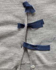 """Little loops give a sweater color and texture. Remove buttons. Cut one 8"""" piece of tape per button. Fold tape in half, and sew to placket; pull loop through button hole & tie."""