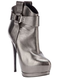 Grey metallic leather boots from Giuseppe Zanotti featuring an almond shape toe, a cross strap design to the sides with a silver loop, a rear zip fastening, a concealed platform, a high stiletto heel and a leather sole.