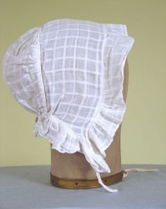 White cotton checked-weave cap, 1830-1850.