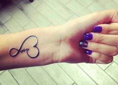 Little tattoo saying Love, surrounded by a heart shape.
