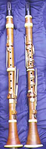 boxwood clarinets, assembled by a non player, since those mouthpieces are BACKWARDS. Geesh!