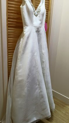 Size 12 Wedding Dress with Embellishments from Mind Charity Shop in Harrow.