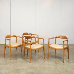 Hans J. Wegner (1914-2007) Four The Chair (Round) chairsJohannes Hansen, oak, upholstery, branded JOHANNES HANSEN COPENHAGEN DENMARK JH, some with Knoll paper labelheight 30 3/8in (77cm); width 24 3/4in (63cm); depth 18 1/2in