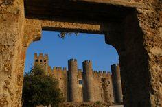 O Castelo de Óbidos localiza-se na freguesia de Santa Maria, vila e concelho de Óbidos, no distrito de Leiria, em Portugal Beautiful Castles, Santa Maria, Portugal, Castles, Sidewalk, Virgin Mary