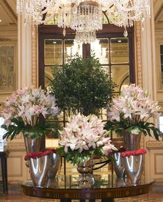 The perfect blend of pinks captivate visitors in the main lobby of The Plaza Hotel this week. From the lush Star Lilies, to the unique fuchsia Cockscombs, the harmony of this design radiates beauty.