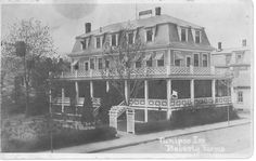 The building that once was the infamous Tunipoo Inn still stands today just down the street from the library on Vine Street. 100 years at the Farms!