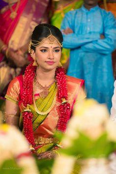 South Indian bride. Gold Indian bridal jewelry.Temple jewelry. Jhumkis.Green silk kanchipuram sari with contrast red blouse.braid with fresh jasmine flowers. Tamil bride. Telugu bride. Kannada bride. Hindu bride. Malayalee bride.Kerala bride.South Indian wedding.