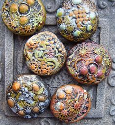 Armor-polymer clay beads by Gabriel Studios.