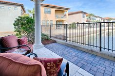 The private upstairs master balcony is the best seat in the house for canal views at Villa Lago 1952 in Sandestin Golf & Beach Resort!